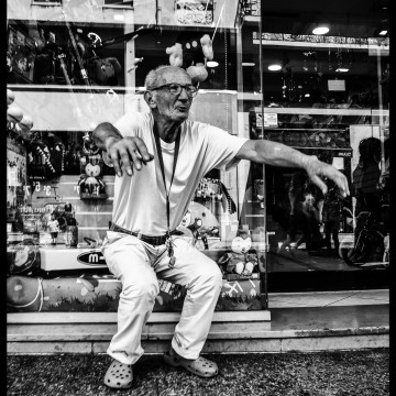 The Old Man, his Cigarette and the Toy Shop